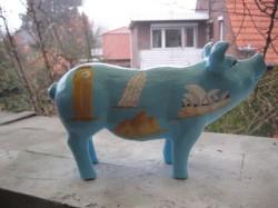 Sparschwein mit verschiedenen Reisezielen_1